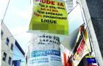 Com promessas de amor e lucro, lafaietenses desafiam a lei e poluem a cidade com cartazes por toda parte